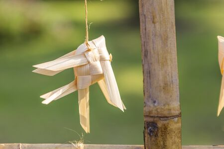 Bamboo fish mobile over blurred nature green background, Thai style decorate item, hand woven bamboo fish Stok Fotoğraf