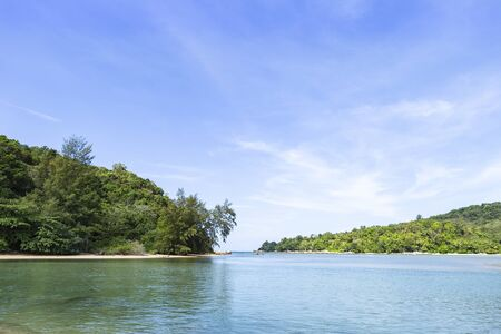 Green island with blue sky and clear sea water, nature concept, summer holiday destination, paradise island