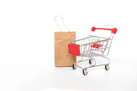 New shopping cart with brown paper shopping bag isolate on white background, business object concept, buy and sale online shopping