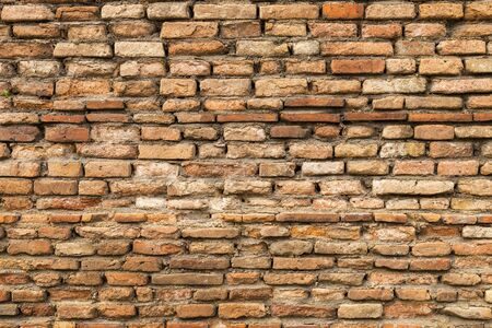 Old brick wall background, old clay brick wall
