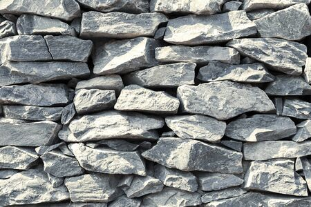 Stone wall background, grey stone stack, outdoor day light