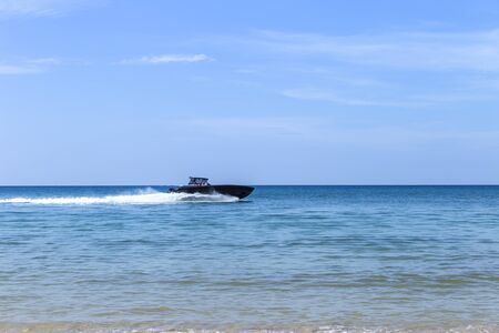 Speed boat on blue sea over clear blue sky, summer outdoor day light, fast transportation Foto de archivo