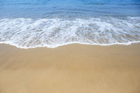 Clean beach with white wave, summer outdoor day light, relaxing on the beach