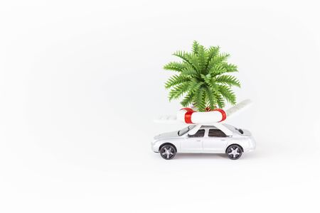 Summer holiday trip concept, summer set on car roof isolate on white background, insurance business idea