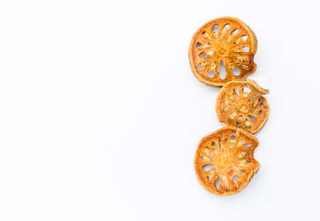 Dry bael fruit isolate on white background, dry fruit to make herb tea