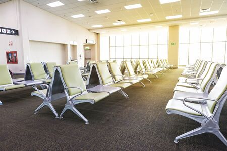 Empty terminal at the airport, waiting area at departure gate, indoor day light, airline business Archivio Fotografico