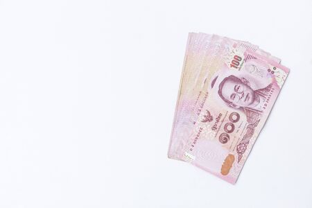 Thai money on white background, investment and banking concept, financial background Imagens