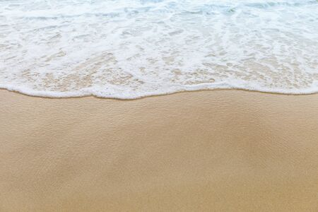 White wave on fine sand beach, nature concept background, summer outdoor day light Stock Photo
