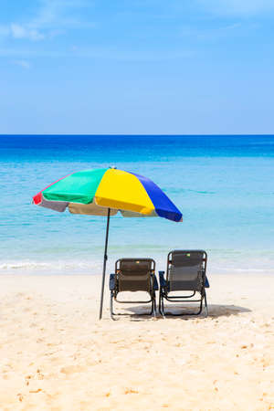 Colorful beach umbrella on the beach, summer holiday to the sea, summer outdoor day light Stok Fotoğraf - 155036577