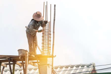 Female labor working at concstruction site, girl building house, work safety, construction business Stok Fotoğraf - 155443067