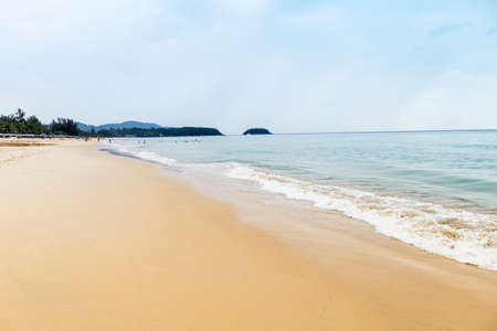 Beautiful clean beach on Phuket island in south of Thailand, summer holiday break destination to Asia, Tourist on the beach, cloudy sky with blue sea water Stok Fotoğraf - 155443974