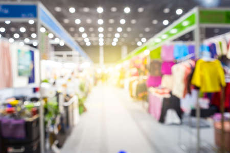 Abstract blurred inside exhibition hall with fashion shop background with vintage warm light Stok Fotoğraf