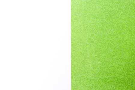 Green paper with Chinese pattern on white background, web or presentation background idea