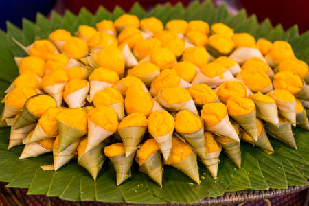 toddy palm cake on banana leaf, Traditional Thai style dessert made from palm fruit and flour wrap with fresh leaf