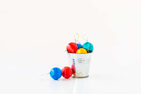 Shiny colorful ball in metal bucket isolate on white background, Christmas decoration item Stok Fotoğraf