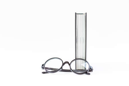 Eye glasses with book isolate on white background, education concept background Stok Fotoğraf