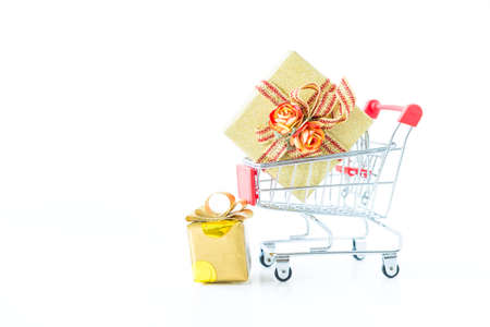 Beautiful gift box in shopping cart isolate on white background, Christmas and new year gift idea background Stok Fotoğraf