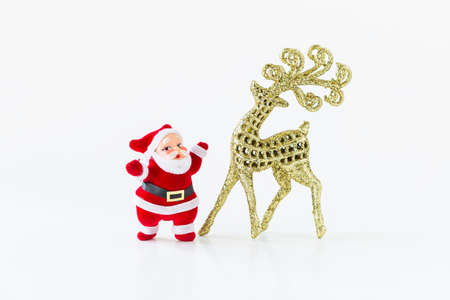 Santa claus doll and shiny gold glitter reindeer isolate on white background, Christmas concept background, festive season decoration object