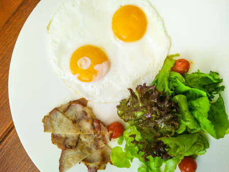 Fried egg with grill ham and fresh vegetable salad, healthy breakfast, healthy food concept Stok Fotoğraf