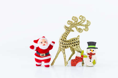 Miniature santa and golden reindeer with Christmas decoration item isolate on white background, Christmas concept background Stok Fotoğraf