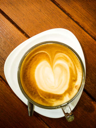 Closeup coffee latte from top view on wooden table background, hot beverage, coffee shop Stok Fotoğraf