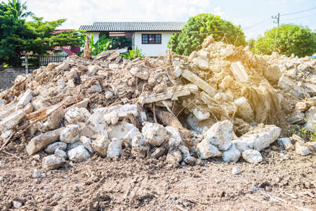 Cement waste mountain at the construction site, space clearing to build the house, environmental