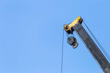 Top of pick and carry crane over clear blue sky background, construction industry concept Stok Fotoğraf