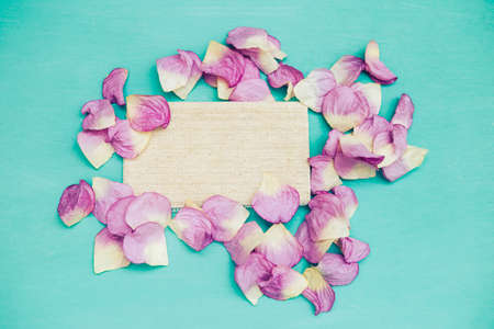 Canvas fabric with pink rose flower leaves on blue background, valentine concept background, greeting card, spring season