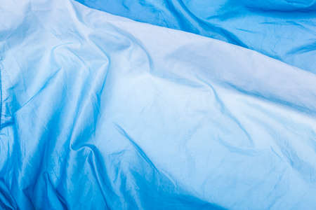 Abstract  crumpled Blue and White Gradient background, blank blue fabric texture background