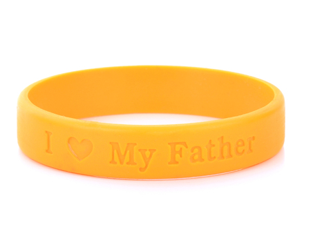 Blank rubber plastic stretch yellow bracelet isolated on white background. Stock Photo