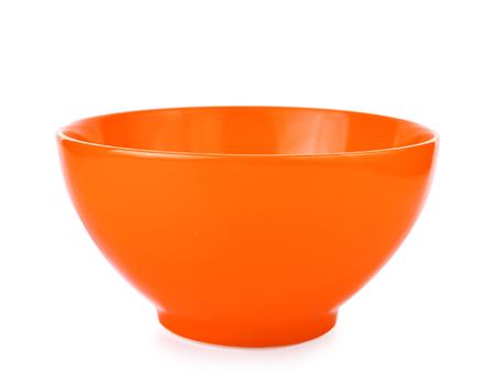 eating utensils: Orange empty bowl isolated on white background