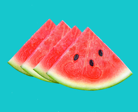 closeup of some pieces of refreshing watermelon on a bule background