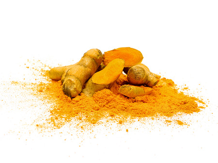 Fresh turmeric slices and powder isolated on white background