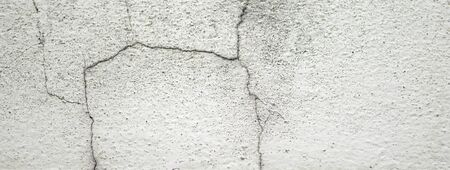 white concrete wall texture;damaged wall.