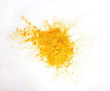 Turmeric (Curcuma) powder pile isolated on white background, top view.turmeric for indian food. Stock fotó