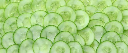 Close up of fresh cucumber slices background; vegetable for vegan food.,healthy food. Stock fotó