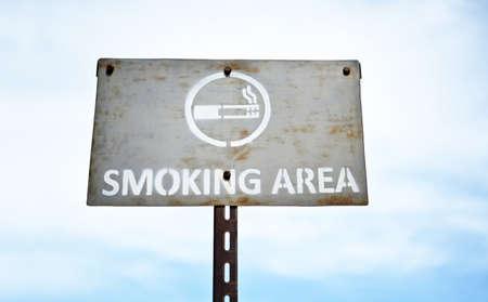 smoking area signboard ;allow smoking in the sky. Archivio Fotografico