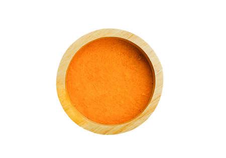 Turmeric powder  isolated in wood bowl ,turmeric is herb,turmeric vitamin C,Vitamin C for protect virus. Stock fotó