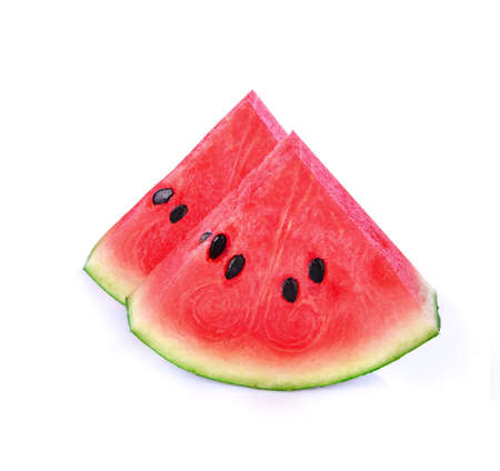 closeup of some pieces of refreshing watermelon on a white background ;fruit for vitamin A and Beta carotene. Stock fotó
