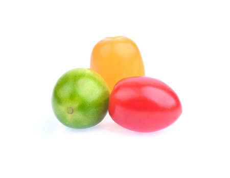 Yellow , red and green  tomato cherry isolated on white; fresh vegetable for salad. Stock fotó