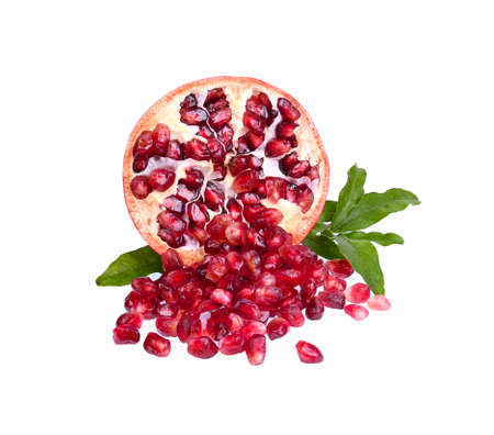 fresh Pomegranate and leaves isolated on white backgroundred fruit high vitamin A and  Anti-oxidant