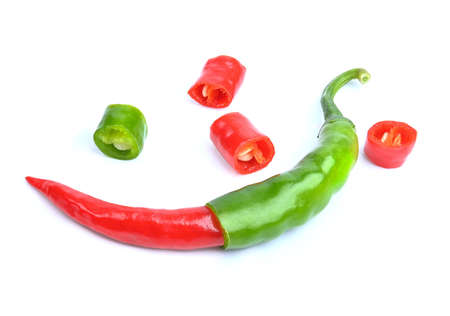 Red and Green hot chilli peppers with slice on white background.