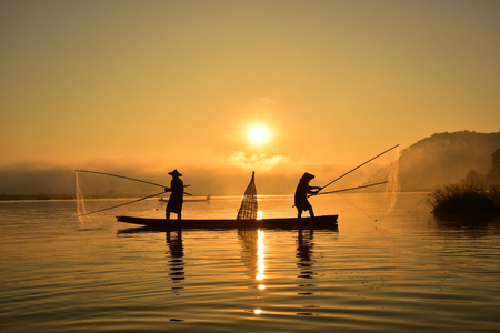 entrapment: Fishermen in action when fishing in the mekong river , Thailand Stock Photo