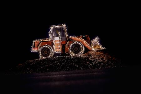 construction wheel loader decorated with lights at christmas