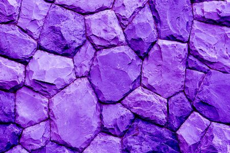 overbuilding: stone wall texture background violet tone