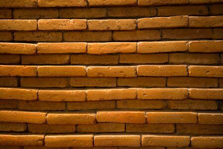 tungsten: blurry brick wall background under tungsten light Stock Photo