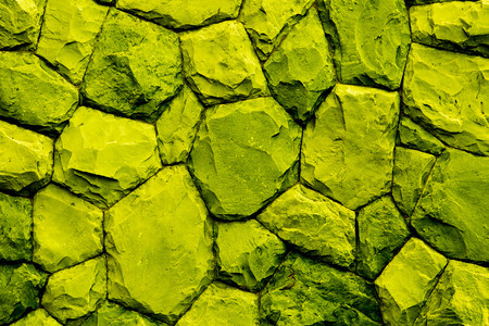 overbuilding: stone wall texture background yellow tone