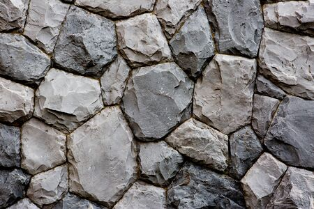 overbuilding: stone wall texture background Stock Photo