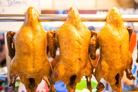 chinese meal: pot-stewed duck on the stainless line in the market