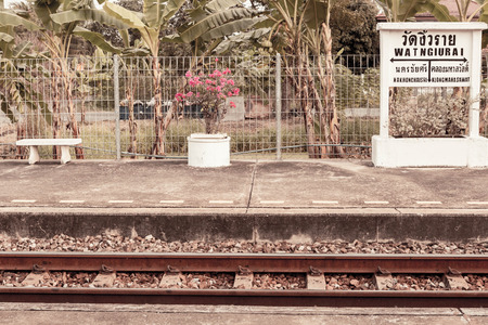 split rail: Vintage filter : Lonely Wat ngiu rai train station ,Thailand